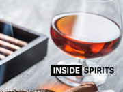 Inside Spirits whisky shot and cigar smoke